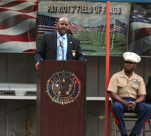 Marine Corps Logistics Base Albany Commanding Officer Col. Alphonso Trimble joined other dignitaries to honor those who paid the ultimate price on September 11, 2001 during the annual Field of Flags remembrance ceremony held by the American Legion Post 30. Trimble and guest speaker, John Tibbits, were in the Pentagon on the day of the terror attacks. (U.S. Marine Corps photo by Re-Essa Buckels).