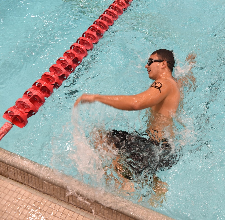 Staff Sgt. Roger Barrett, a 28th Maintenance Squadron aerospace ground equipment technician, turns around to start another lap in a pool at Ellsworth Air Force Base, S.D., Sept. 15, 2018. The 28th Force Support Squadron hosted the tri-to-b1 triathlon, which consisted of a 500-meter swim, a five-kilometer run and a 10-kilometer bicycle ride. (U.S. Air Force Photo by Airman 1st Class Thomas Karol)