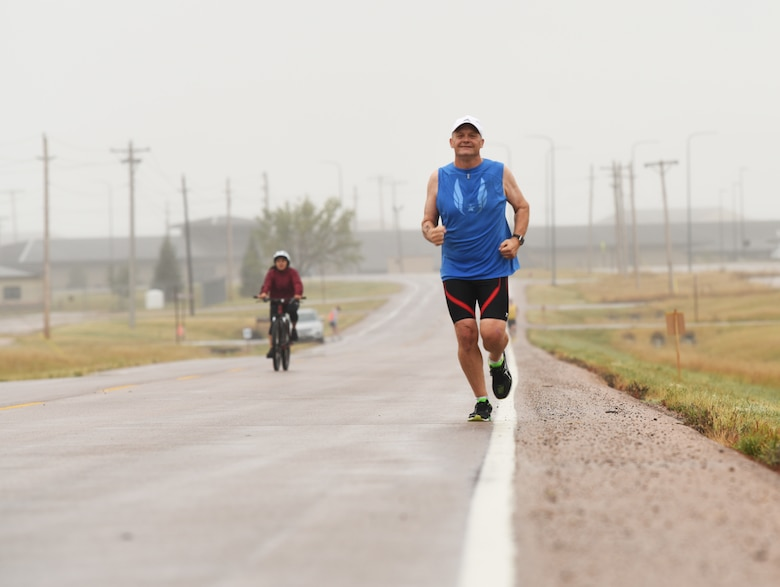 Jens Christenson, a 28th Civil Engineer Squadron engineer, runs a five kilometer race as part of a triathlon at Ellsworth Air Force Base, S.D., Sept. 15, 2018. The 28th Force Support Squadron hosted the tri-to-b1 triathlon, which consisted of a 500-meter swim, a five-kilometer run and a 10-kilometer bicycle ride. (U.S. Air Force Photo by Airman 1st Class Thomas Karol)