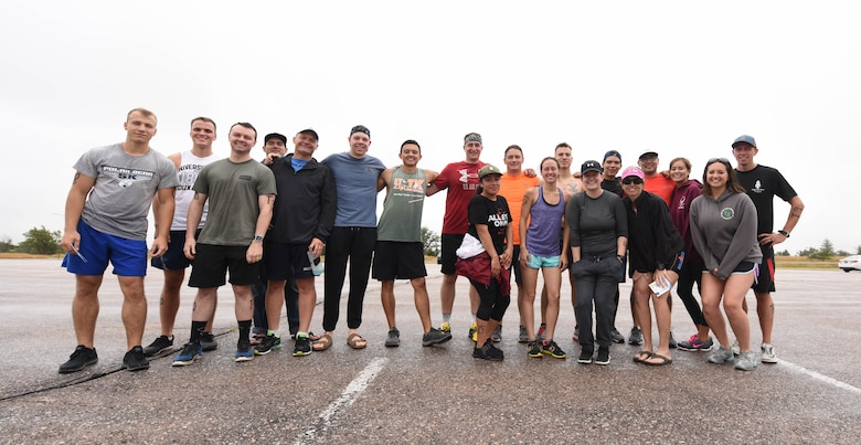 Participants of the tri-to-b1 triathlon, pose for a picture at Ellsworth Air Force Base, S.D., Sept. 15, 2018. The 28th Force Support Squadron hosted the tri-to-b1 triathlon, which consisted of a 500-meter swim, a five-kilometer run and a 10-kilometer bicycle ride. (U.S. Air Force Photo by Airman 1st Class Thomas Karol)