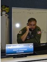 Lt. Col. Lewis Hagler, 601st Air Operations Center Air Mobility Division, chief, air mobility execution, discusses potential airlift operations for Hurricane Florence. Total Force representation during AFNORTH's Defense Support of Civil Authorities efforts includes active-duty U.S. Navy, U.S. Marine Corps, U.S. Army, U.S. Coast Guard, and U.S. Air Force, Guard, Reservists and civilians. (Air Force photo by Mary McHale)