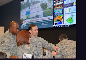 Master Sgt. Sheri Burkes, Staff Sgt. Matthew Betts and Capt. Jonathan Washburn, personnelists from the 186th Air Operations Group, Key Field, Miss., review personnel data as part of the Contingency Action Team activated at Air Forces Northern Headquarters to help support AFNORTH's Defense Support of Civil Authorities mission. Total Force representation during AFNORTH's DSCA efforts includes active-duty U.S. Navy, U.S. Marine Corps, U.S. Army, U.S. Coast Guard, and U.S. Air Force, Guard, Reservists and civilians. (Air Force photo by Mary McHale)