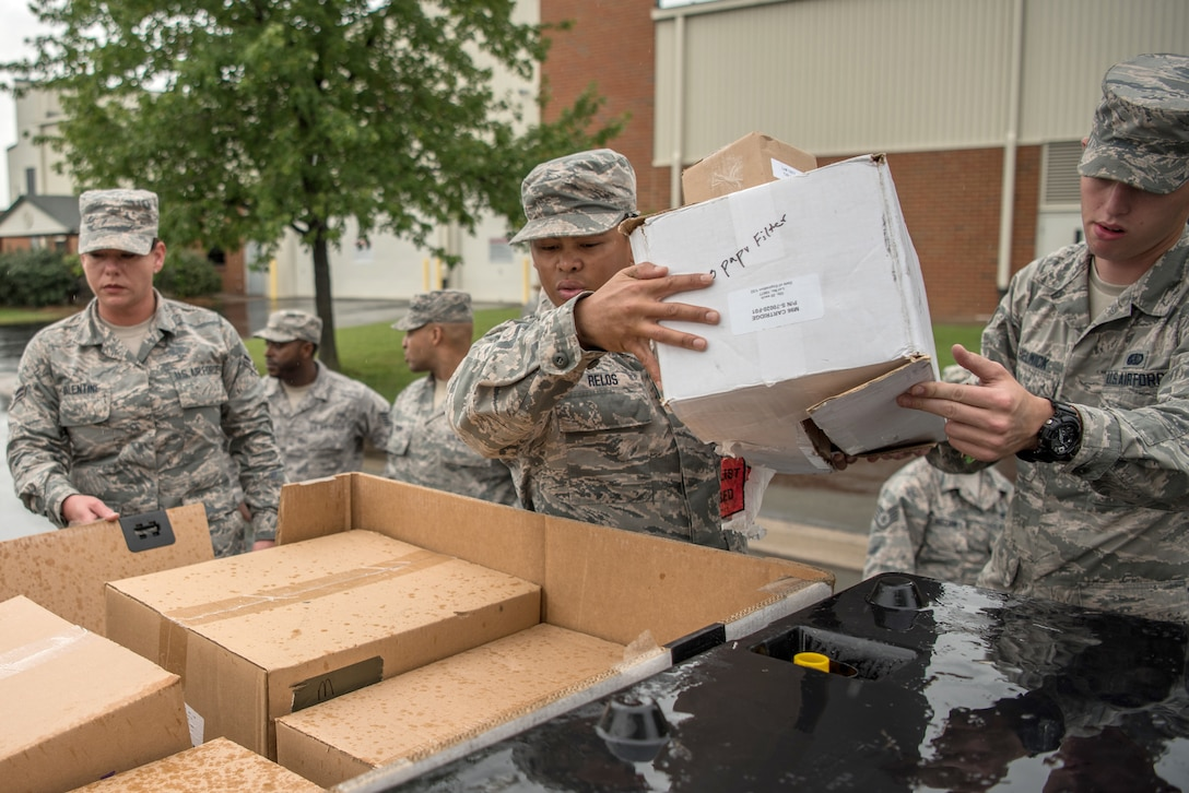 Members of the 123rd Airlift Wing's Fatality Search and Recovery Team pack equipment at the Kentucky Air National Guard Base in Louisville, Ky., Sept. 17, 2018, prior to deploying to North Carolina to support operations in the wake of Hurricane Florence. The team, which specializes in the dignified recovery of deceased personnel, will assist the North Carolina medical examiner's office at the request of local health officials.