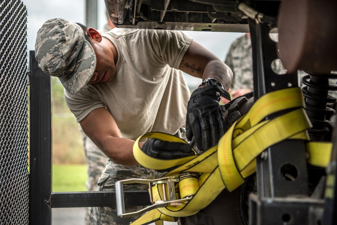 Members of the 123rd Airlift Wing's Fatality Search and Recovery Team strap down equipment at the Kentucky Air National Guard Base in Louisville, Ky., Sept. 17, 2018, prior to deploying to North Carolina to support operations in the wake of Hurricane Florence. The team, which specializes in the dignified recovery of deceased personnel, will assist the North Carolina medical examiner's office at the request of local health officials.