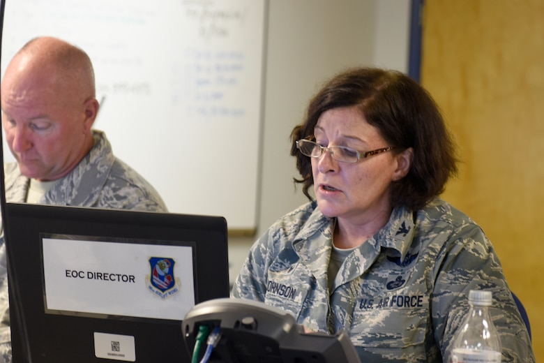 U.S. Air Force Col. Shawne Johnson, 145th Airlift Wing Emergency Operation Center (EOC) day-shift director, maintains telecommunications during Tropical Storm Florence, Sept. 15, 2018. Col. Johnson's position as the EOC day-shift director is to manage and maintain assets and people while channeling communication up and down the North Carolina Air National Guard in response to Tropical Storm Florence.