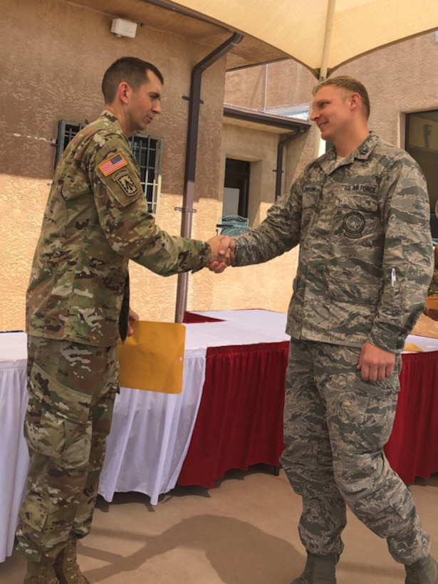 Capt. Jason Allenton, right, assigned to the 225th Air Defense Squadron, graduates from Air Defense Artillery Fire Control Officers (ADAFCO), Kirkland Air Force Base, New Mexico, July 27, 2018.   Experience gained at the ADAFCO course assists the Western Air Defense Sector in mission planning, execution and coordination of Army assets as part of Operation Noble Eagle. (Courtesy photo by Capt. Jason Allenton)