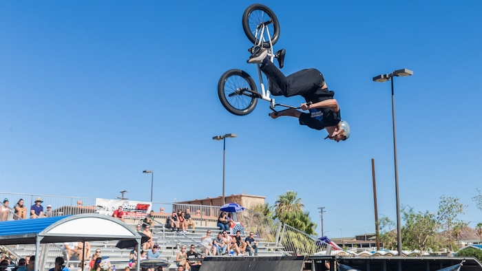 Kole Voelker, professional BMX rider and X-Games athlete, Performs a front flip during the X-Games Action Sports Show at the Marine Corps Exchange parking lot aboard the Marine Corps Air Ground Combat Center, Twentynine Palms, Calif., Sept. 8, 2018. The X-Games provided a social recreational event in honor of the continuous service and sacrifice military personnel and family members make for the country. (U.S. Marine Corps photo by Pfc. Robin Lewis)