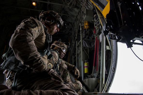 Master Sgt. Jim Brucculeri and Staff Sgt. Kareem Spearman from the 102nd Rescue Squadron, New York Air National Guard, scan for people in need of rescue over Kinston, N.C. Sept. 16, 2018. (U.S. Air Force photo by Senior Airman Kyle Hagan)