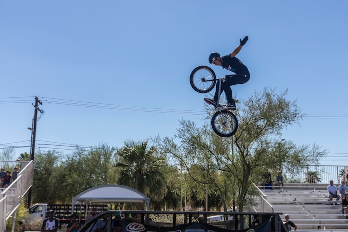 Seth Riley, professional BMX rider and X-Games athlete, performs a tuck no hander during the X-Games Action Sports Show at the Marine Corps Exchange parking lot aboard the Marine Corps Air Ground Combat Center, Twentynine Palms, Calif., Sept. 8, 2018. The X-Games provided a social recreational event in honor of the continuous service and sacrifice military personnel and family members make for the country. (U.S. Marine Corps photo by Pfc. Robin Lewis)