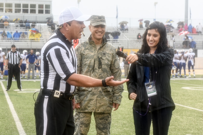 Head referee, Matt Jones, displays the coin used for the coin toss to start the game during the Military Appreciation Day, at the LeGrand stadium, in San Angelo, Texas, Sept. 15, 2018. Angelo State University played Texas A&M Kingsville in their Lone Star conference opener. (U.S. Air Force photo by Aryn Lockhart/Released)