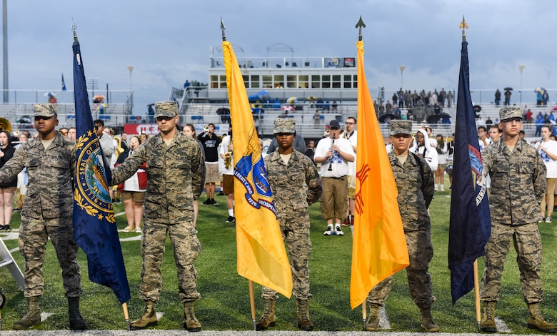 Goodfellow volunteers stand with all 50 flags of the U.S. during the half-time ceremony for Military Appreciation Day, at the LeGrand stadium, in San Angelo, Texas, Sept. 15, 2018. The volunteers converged at the 50-yard line while the Ram Band played the military service songs. (U.S. Air Force photo by Aryn Lockhart/Released)