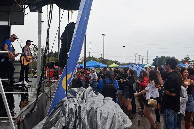 Those willing to endure the rain were able to listen to Wade Bowen perform during the Ram Jam segment of the Military Appreciation Day at the LeGrand Alumni and Visitor's Center, in San Angelo, Texas, Sept. 15, 2018. The Ram Jam also offered free food and a place to socialize before the start of the Angelo State University football game. (U.S. Air Force photo by Airman 1st Class Zachary Chapman/Released)