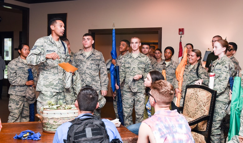 U.S. Air Force Tech. Sgt. Joseph Washington, 312th Training squadron military training leader, provides last minute details to the volunteers participating during the Military Appreciation Day at the LeGrand Alumni and Visitors Center, in San Angelo, Texas, Sept. 15, 2018. Goodfellow Air Force Base provided 50 volunteers to carry state flags during the half-time show. (U.S. Air Force photo by Aryn Lockhart/Released)