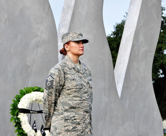 Master Sgt. Melissa Erwin, 340th Flying Training Group stands vigil at the Missing Man Monument during Sept. 17 POW/MIA Recognition Week observances at Joint Base San Antonio-Randolph, Texas. (U.S. Air Force photo by Janis El Shabazz)