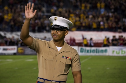 U.S. Marine Corps Sgt. Mattxyrill Vidal, Administration Clerk, 12th Marine Corps District, waves at the audience during the San Diego State University vs. Arizona State University college football game at San Diego County Credit Union Stadium, San Diego, Sept. 15, 2018. Marines were recognized throughout the duration of the game for their patriotic service.