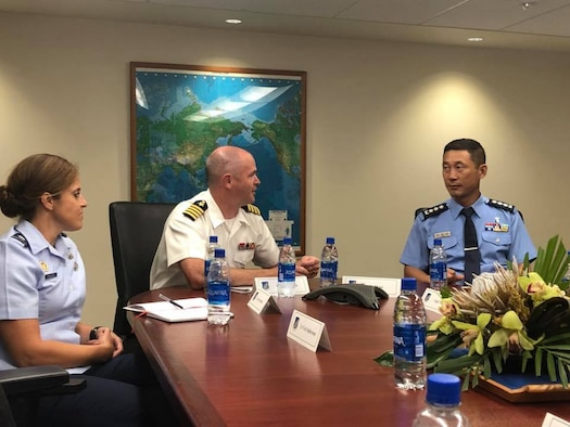 U.S. Navy Capt. William Kafka, Indo-pacific Command Public Affairs Officer and Air Force Lt. Col. Megan Schafer, Pacific Air Forces PA Director brief Republic of Korea Air Force Col. Sang-kyu Lee, Cheif of PA, about the importance of strategic communication at Joint Base Peral Harbor-Hickam, Hawaii Sept. 11, 2018. ROKAF officers visited PACAF/PA to discuss the importance of communicating in an integrated, synchronized, and purposeful way to build a united PA system capable of achieving common operational goals in case of emergencies and bilateral operations. (U.S. Air Force photo by Master Sgt. Nadine Y. Barclay)