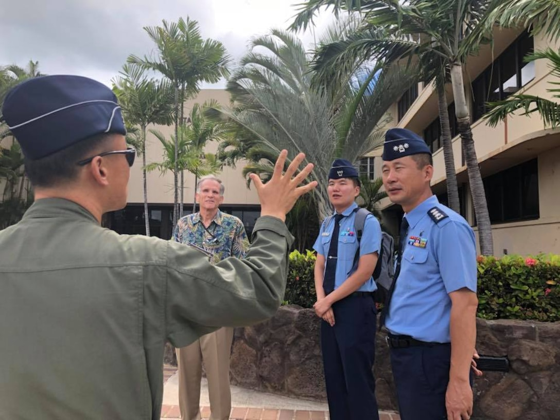 Republic of Korea Air Force Public Affairs Officers receive a Welcome Brief out the Pacific Air Forces Headquarters at Joint Base Pearl Harbor-Hickam, Hawaii Sept. 11, 2018. During the brief, ROKAF officers learned about the history of the attacks on Pearl Harbor on Dec. 7, 1941 and the impacts they had on various air fields around the island of Oahu. (U.S. Air Force photo by Master Sgt. Nadine Y. Barclay)