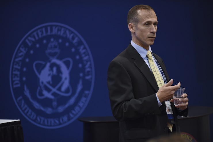 Ian Fowlie, an employee with the Defense Intelligence Agency Chief Information Office, briefs attendees on the CIO Digital Journey during the 2018 Department of Defense Intelligence Information System Worlwide Conference in Omaha, Nebraska August 13, 2018.