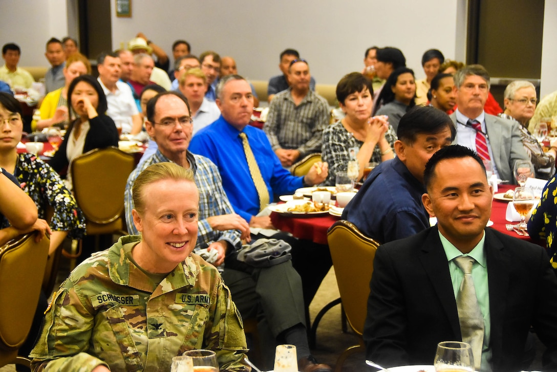 Col. Teresa Schlosser (left), U.S. Army Corps of Engineers, Far East District commander, shares a laugh with Jamie Hagio, Area Engineer, Humphreys Area office, during his Farewell luncheon held at Taproom restaurant, Camp Humphreys, Sep.12.