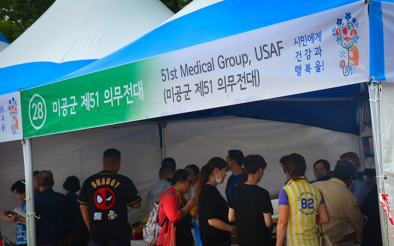 Guests visit a booth set up by the 51st Medical Group during the Pyeongtaek Health Festival in Pyeongtaek, Republic of Korea, Sept. 16, 2018.