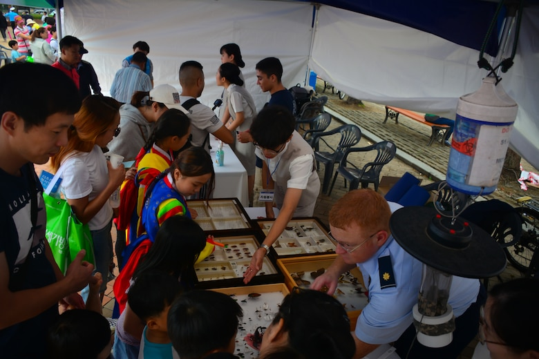 Members of the 51st Aerospace Medicine Squadron Public Health flight, Bio-environmental Engineering flight, and students from local high schools show visitors an U.S. military field ration at the Pyeongtaek Health Festival in Pyeongtaek, Republic of Korea, Sept. 16, 2018.