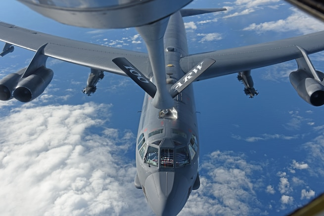 A U.S. Air Force B-52 Stratofortress receives fuel from a U.S. Air Force KC-135 Stratotanker during an air-refueling mission off the coast of Norway, Sept. 15, 2018. The purpose of the flight was to conduct theater familiarization for aircrew members and to demonstrate U.S. commitment to allies and partners through the global employment of our military forces. (U.S. Air Force photo by Senior Airman Luke Milano)