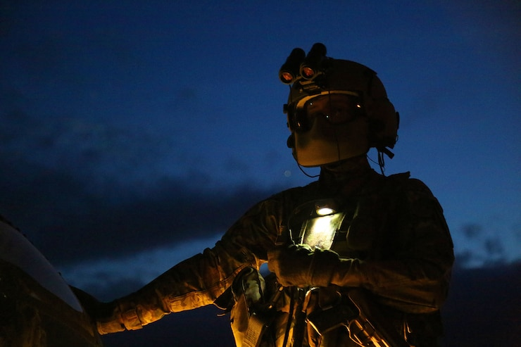 U.S. Army Spc. Michael Pitman, attached to 2nd Battalion, 227th Aviation Regiment, TF Lobos, 1st Air Cavalry Brigade (ACB), waits for the next pre-flight check, Hohenfels, Germany, April 30, 2018.