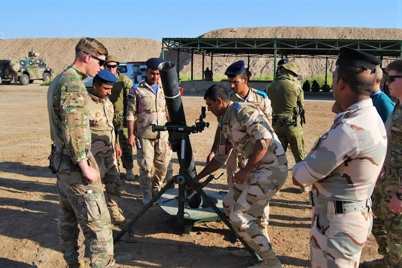 U.S. and Australian troops train members of the Iraqi Security Forces on a new  mortar system.