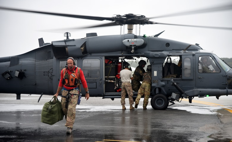 Senior Master Sgt. Wes Hufnagel, a pararescueman, departs on an HH-60 Pave Hawk helicopter at Joint Base Charleston, S.C., Sept. 15, 2018. Airmen and equipment from the 334th Air Expeditionary Group arrived at Joint Base Charleston, S.C. aboard HC-130J Combat King II aircraft and HH-60G Pave Hawks from Moody Air Force Base, Georgia. The 344th AEG is being pre-positioned to be ready to provide search-and-rescue relief in the wake of Hurricane Florence. The 334th AEG is an expeditionary search-and-rescue unit comprised of 23d Wing (Moody AFB, Ga.) and 920th Rescue Wing (Patrick AFB, Florid) personnel and assets ready to perform surface, fixed- wing and rotary SAR operations when needed. (U.S. Air Force Photo by Technical Sgt. Kelly Goonan)