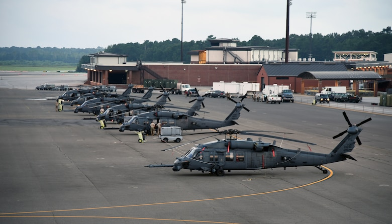 HH-60 Pave Hawk helicopter aircrew Airmen with the 334th Air Expeditionary Group, sit alert on the Joint Base Charleston, S.C.flightline Sept. 16, 2018. The 334th AEG is comprised of Airmen and assets from the 920th Rescue Wing (Patrick Air Force Base, Florida) and the 23d Wing (Moody Air Force Base, Georgia) which stand ready to provide search-and-rescue relief efforts in South Carolina to execute search and rescue operations for those who may be impacted by Hurricane Florence. (U.S. Air Force photo/Tech. Sgt. Kelly Goonan)