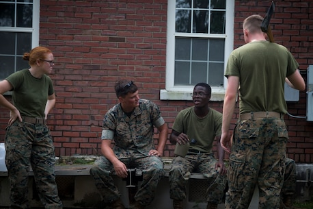 U.S. Marines with Headquarters Regiment, 2nd Marine Logistics Group, take a brief moment to rest while cleaning up debris at Camp Lejeune, N.C., Sept. 17, 2018. Recovery and repair efforts began on base Saturday, September 15, with the majority of efforts focused on clearing roadways and restoring power to critical areas aboard Camp Lejeune following Hurricane Florence. (U.S. Marine Corps photo by Sgt. Bethanie C. Sahms)