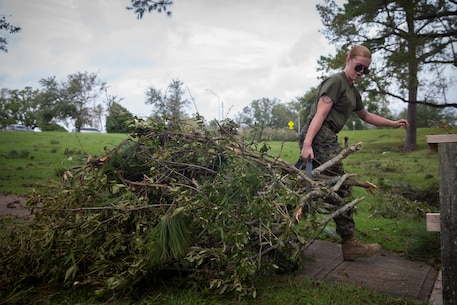 U.S. Marine Corps Cpl. Kayla Buchanan with Service Company, Headquarters Regiment, 2nd Marine Logistics Group, hauls away debris at Camp Lejeune, N.C., Sept. 17, 2018. Recovery and repair efforts began on base Saturday, September 15, with the majority of efforts focused on clearing roadways and restoring power to critical areas aboard Camp Lejeune following Hurricane Florence. (U.S. Marine Corps photo by Sgt. Bethanie C. Sahms)