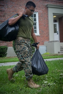 U.S. Marine Corps Pfc. Jose Puente with Communications Company, Headquarters Regiment, 2nd Marine Logistics Group, hauls away bags of debris at Camp Lejeune, N.C., Sept. 17, 2018. Recovery and repair efforts began on base Saturday, September 15, with the majority of efforts focused on clearing roadways and restoring power to critical areas aboard Camp Lejeune following Hurricane Florence. (U.S. Marine Corps photo by Sgt. Bethanie C. Sahms)