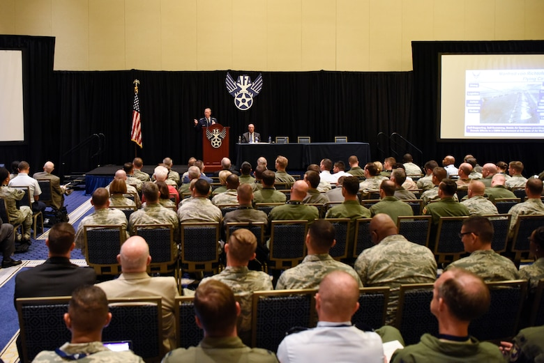 "Airmen attend a speech on ""The Force We Present"" by Lt. Gen. Mark D. Kelly, Air Force deputy chief of staff or operations, during the Air Force Association's Air, Space and Cyber Conference Sept. 17, 2018, in National Harbor, Md. The Air, Space and Cyber Conference is a professional development conference that offers an opportunity for Department of Defense personnel to participate in forums, speeches, seminars and workshops. (U.S. Air Force photo by Airman 1st Class Zoe M. Wockenfuss)"