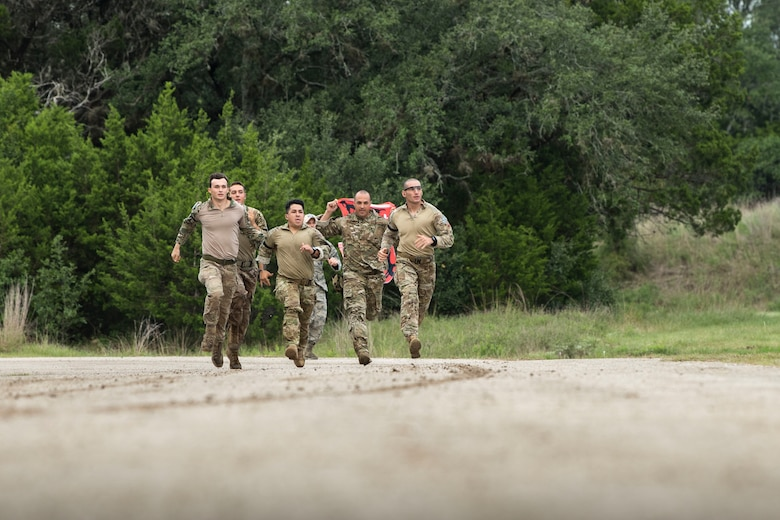 Airmen from Air Combat Command (ACC) sprint to the starting point of a relay during the 2018 Defender Challenge, Sept. 13, at Joint Base San Antonio-Camp Bullis, Texas. Teams representing all twelve Air Force major commands, the Royal Air Force Regiment and German Air Force participated in the friendly competition, which tested their capabilities in dismounted operations, combat endurance and weapons tactics. The ACC team won second place in the overall competition, combat endurance and weapons challenge. (U.S. Air Force photo by Airman Taryn Butler)