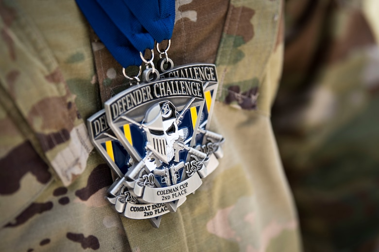 Medals rest on an Airman from Air Combat Command (ACC) during the 2018 Defender Challenge, Sept. 13, at Joint Base San Antonio-Camp Bullis, Texas. Teams representing all twelve Air Force major commands, the Royal Air Force Regiment and German Air Force participated in the friendly competition, which tested their capabilities in dismounted operations, combat endurance and weapons tactics. The ACC team won second place in the overall competition, combat endurance and weapons challenge. (U.S. Air Force photo by Airman Taryn Butler)