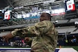 1st Lt. Jarrell Brown pulls the flag taut during practice at AT&T Stadium. He will be one of more than 230 300th Sustainment Brigade and 4th Sustainment Command (Expeditionary) Soldiers that will deploy to Southeast Asia in fewer than 60 days.