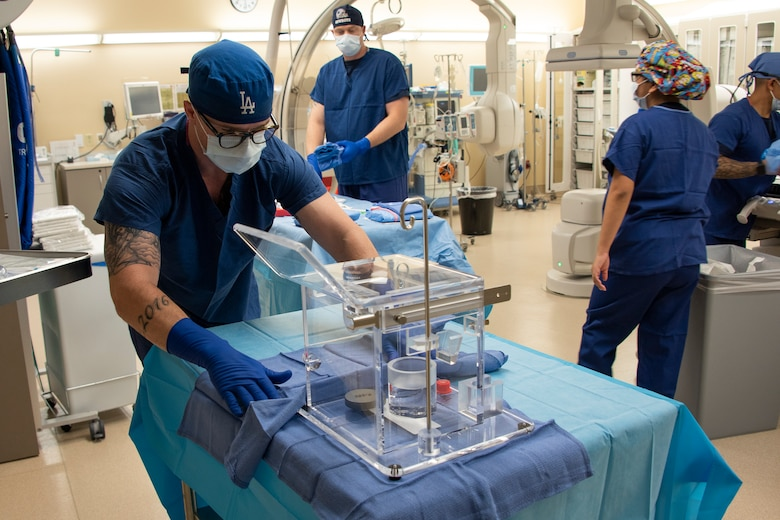 U.S. Air Force Senior Airman Justin Ritzel, 60th Diagnostics and Therapeutics Squadron, prepares a tray of specialized medical equipment ahead of an Yttrium-90 radioembolization procedure for a patient with liver cancer Sept. 7, 2018, atTravis Air Force Base, Calif. The Y-90 radioembolization is an advanced and minimally invasive method utilized to treat cancer by delivering millions of tiny radioactive beads inside the blood vessels that feed a tumor. The high dose of targeted radiation prospectively kills the tumor while sparing normal tissue. This was the first time the treatment was performed at David Grant USAF Medical Center. (U.S. Air Force photo by Heide Couch)