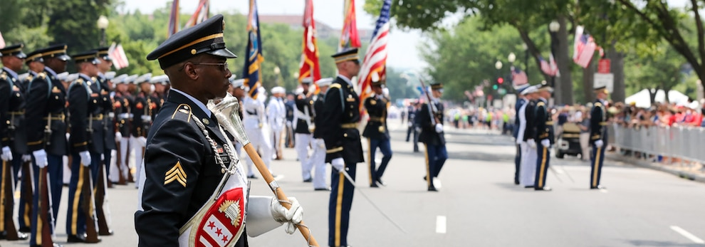 Sgt. Andy Waiters, drum major, 257th Army Band, District of Columbia National Guard, stands in formation along with other marching elements in preparation for the Independence Day parade on July 4, 2018, along Constitution Avenue in Washington, D.C. Soldiers and Airmen of the D.C. Guard also provided support to local and federal partners in securing parade routes.