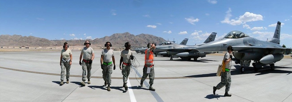 U.S. Air Force 113th wing Ordinance Systems Mechanics, walk off the runway, on Nellis Air Force Base in Nevada. Nearly 200 Airmen and 10 Air Force F-16C Fighting Falcons from the 113th Wing, District of Columbia Air National Guard, deployed to Nellis Air Force Base, in support of exercise Red Flag.