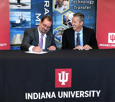 Indiana University's CACR Director Mr. Von Welch and NSWC Crane Technical Director Dr. Brett Seidle re-signed a CRADA agreement on Sept. 13, 2018. The goal is to grow the collaboration between IU and NSWC Crane to improve capabilities in the areas of software assurance and trusted artificial intelligence.