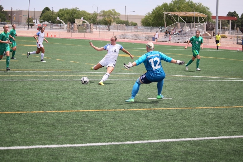 1st. Lt. Carla Cimo shoots and scores during a match against Germany at the Conseil International du Sport Miltiaire (CISM) 11th World Women's Military Football Championship at Stout Field on Fort Bliss, Texas June 20 – July 5. (Courtesy photo)