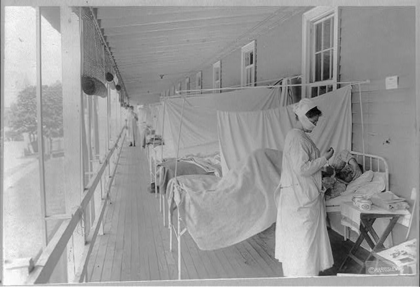 A nurse checks a patient's pulse during a pandemic flu outbreak in 1918.