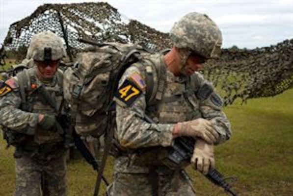Army Capt. Robert Killian, right, with the Colorado Army National Guard, and his teammate, Army Staff Sgt. Erich Friedlein, with the Pennsylvania Army National Guard, head out to their next event while competing in the 2016 Lt. Gen. David E. Grange Jr. Best Ranger Competition at Fort Benning, Georgia.