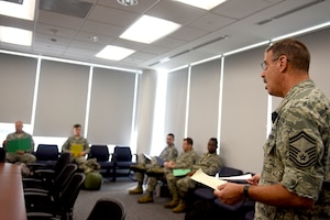U.S. Air Force Senior Master Sgt. Gene Katz, operations and compliance superintendent with the 145th Logistics Readiness Squadron, briefs personnel assigned to an 11-person team ready to assist in Hurricane Florence Relief efforts at the North Carolina (N.C.) Air National Guard Base, Charlotte Douglas International Airport, Sept.17, 2018.  The 11-person team will create and move pallets filled with supplies like food and water in a Kinston, N.C. airport.