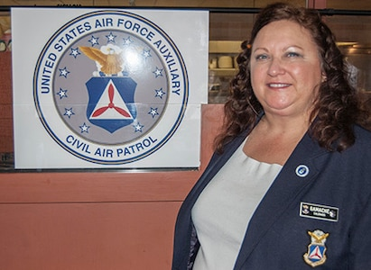 Retired U.S. Air Force Maj. Celeste Gamache, commander of Colorado Wong of the Civil Air Patrol, sponsors an event on behalf of CAP in Denver Dec. 4, 2015. (U.S. Air National Guard photo by Tech. Sgt. Jecca Geffre/Released)