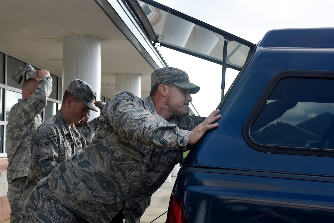 U.S. Air Force Master Sgt. Michael Shepard, 145th Logistics Readiness Squadron (LRS), loads a truck with gear for an 11-person team ready to assist in Hurricane Florence Relief efforts at the North Carolina (N.C.) Air National Guard Base, Charlotte Douglas International Airport, Sept.17, 2018.  The 11-person team will create and move pallets filled with supplies like food and water in a Kinston, N.C. airport.