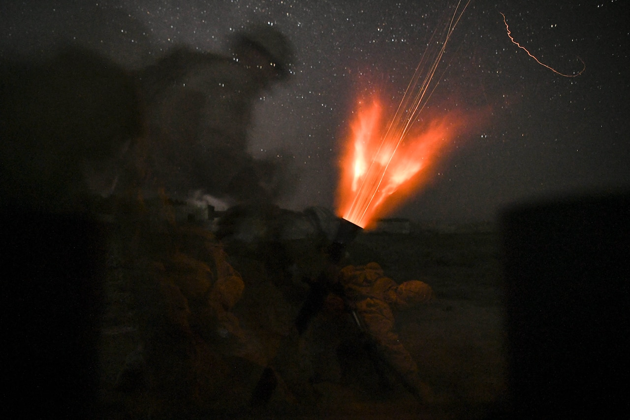 Marines fire mortar.