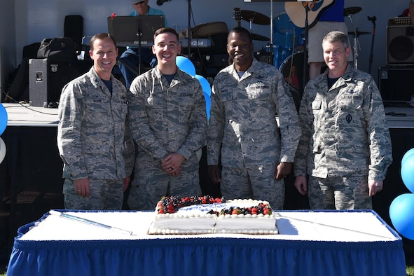 PETERSON AIR FORCE BASE, Colo. - Senior leaders from the 21st Space Wing cut a birthday cake at The Club Sept. 14th, 2018, on Peterson Air Force Base, Colorado, to celebrate the Air Force's 71st birthday. The Air Force became its own service Sept. 18th, 1947. (U.S. Air Force photo by Carrie Grover)