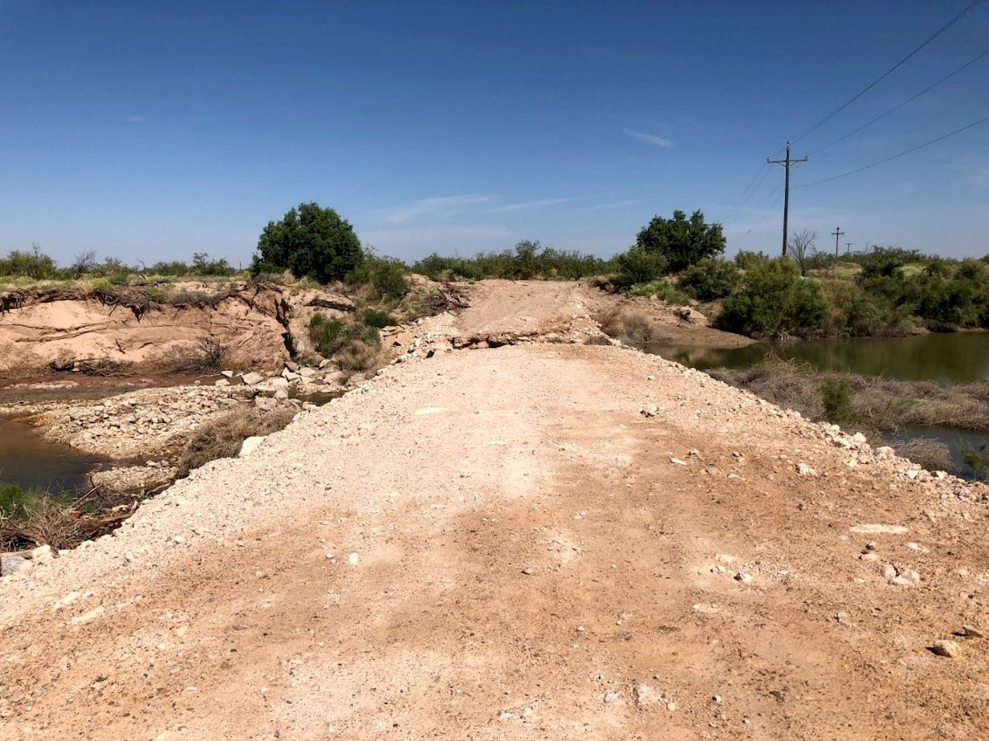 The unauthorized dam, built by Loving County Water Improvement District. The dam was built of broken concrete, petro calcic rock, and sediment.
